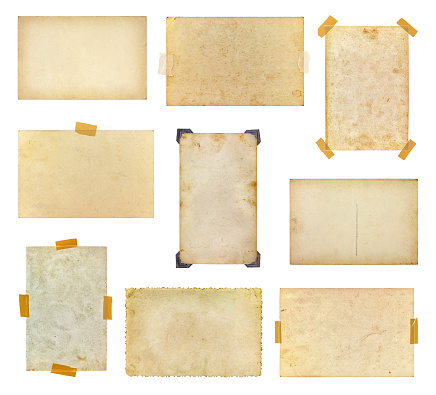 Set of vintage photos taped to a white background