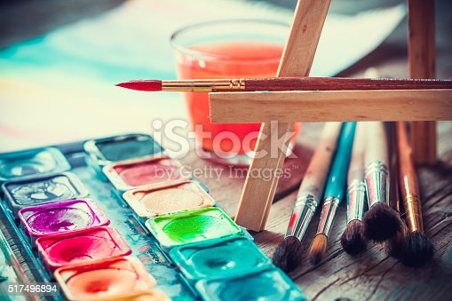 istock Set of watercolor paints and paintrushes for painting closeup. 517496894