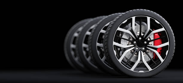 Set of wheels with modern alu rims on black background stock photo
