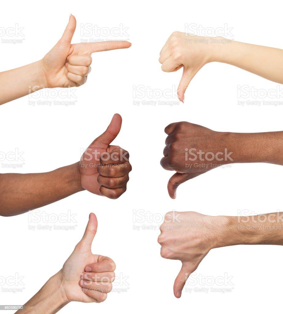 Conjunto de blancas y negras manos haciendo símbolos opuestos - foto de stock