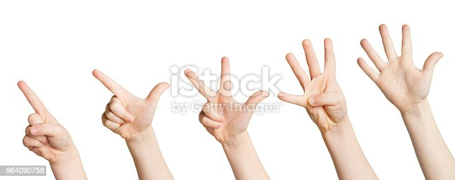 693519466 istock photo Set of white child hands showing figures, counting 964090758