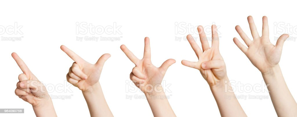 Set of white child hands showing figures, counting stock photo