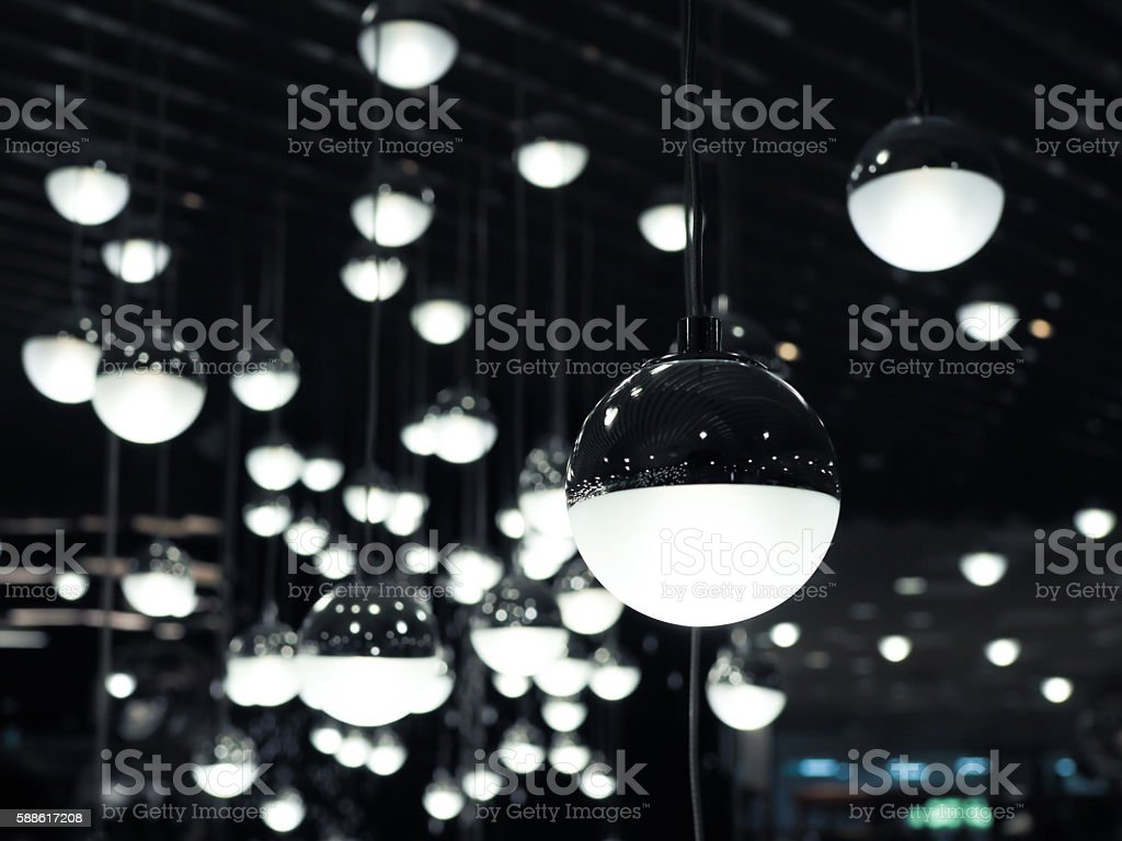 Set of white fluoescent round light bulbs hanging on decorative stock photo