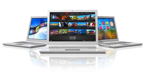 Set of white laptops stock photo