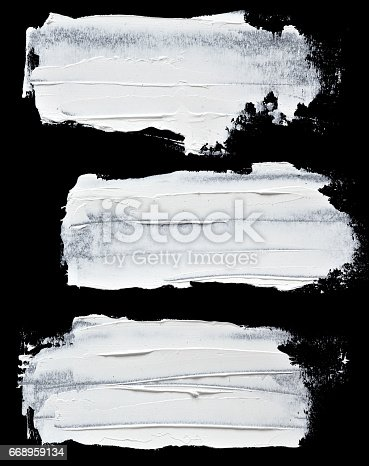 istock Set of white oil paint brush strokes 668959134