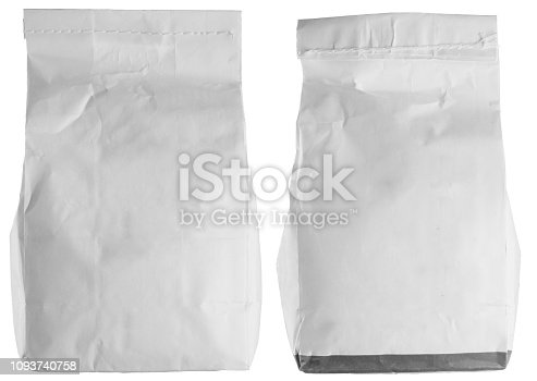912671588istockphoto Set of white paper flour package isolated on white. 1093740758