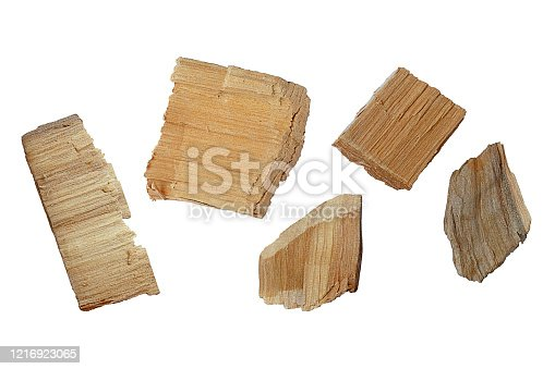 Set of wood chips on a white background. Top view of a group of wood chips on a white background.