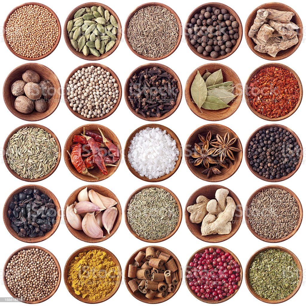 set of wooden bowls with different spices stock photo