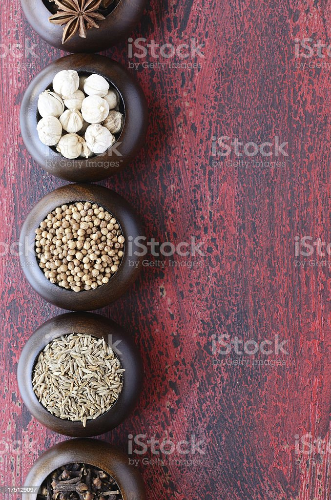 Set of wooden bowls with Indian spices royalty-free stock photo