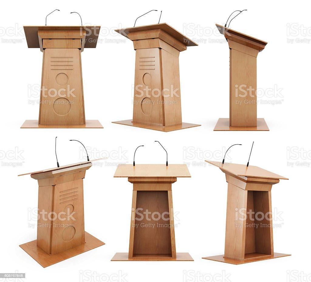 Set of wooden podium tribune with microphones isolated on white stock photo