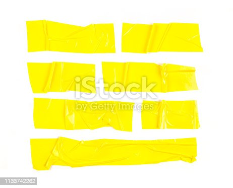 istock Set of yellow tapes on white background. Torn horizontal and different size yellow sticky tape, adhesive pieces. - Image 1133742262