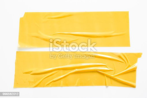 istock Set of yellow tapes on white background. Torn horizontal and different size yellow sticky tape, adhesive pieces. 996582012