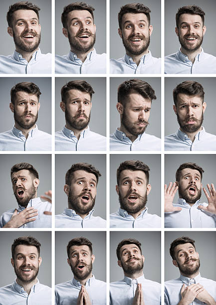 Set of young man's portraits with different emotions stock photo