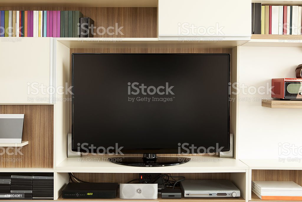 TV set on wall unit stock photo