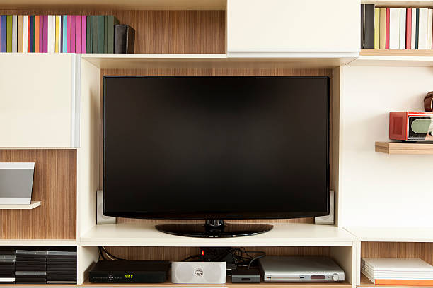 tv set on wall unit - flat screen stock photos and pictures
