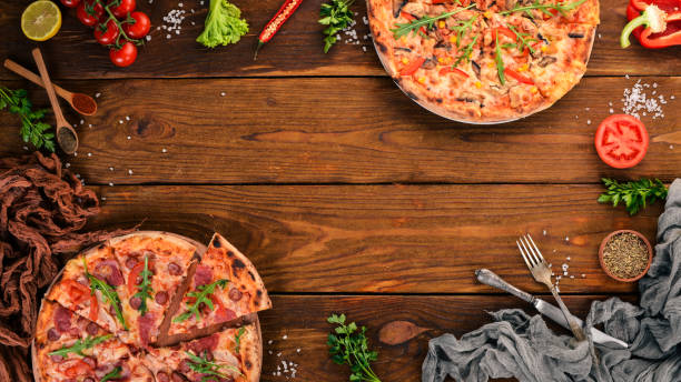 set pizza. italian cuisine. top view. on a wooden background. copy space. - pizzeria stock photos and pictures