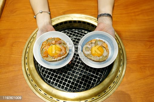 istock Set shell crab of kani miso topped with fresh salmon and yolk egg. 1192821009