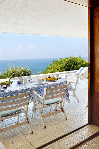 Set table for breakfast: white terrace overlooking the sea, Sardinia stock photo