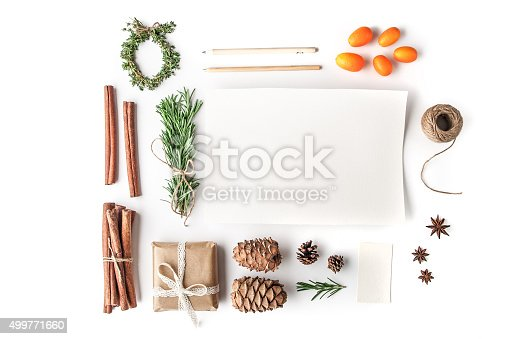 Rosemary , cinnamon , cones , paper , pencil , rope , kumquat , star anise and present on the white background horizontal