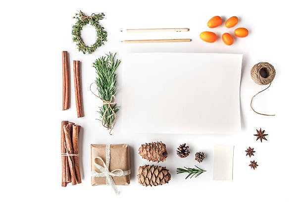 Set to create  Christmas card on the white background horizontal Rosemary , cinnamon , cones , paper , pencil , rope , kumquat , star anise and present on the white background horizontal star anise on white stock pictures, royalty-free photos & images