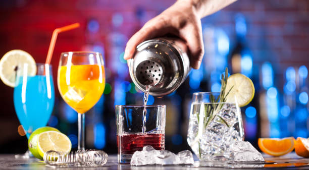 Set with different cocktails on bar tender stock photo