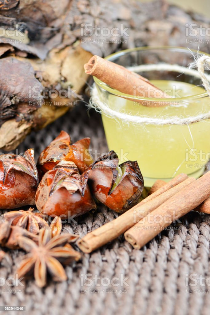 Set with star anise fried chestnut honey and cinnamon sticks royalty-free stock photo