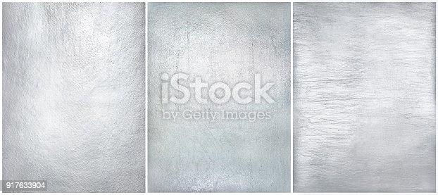 istock Set worn metal plate steel background. Texture silver foil. 917633904