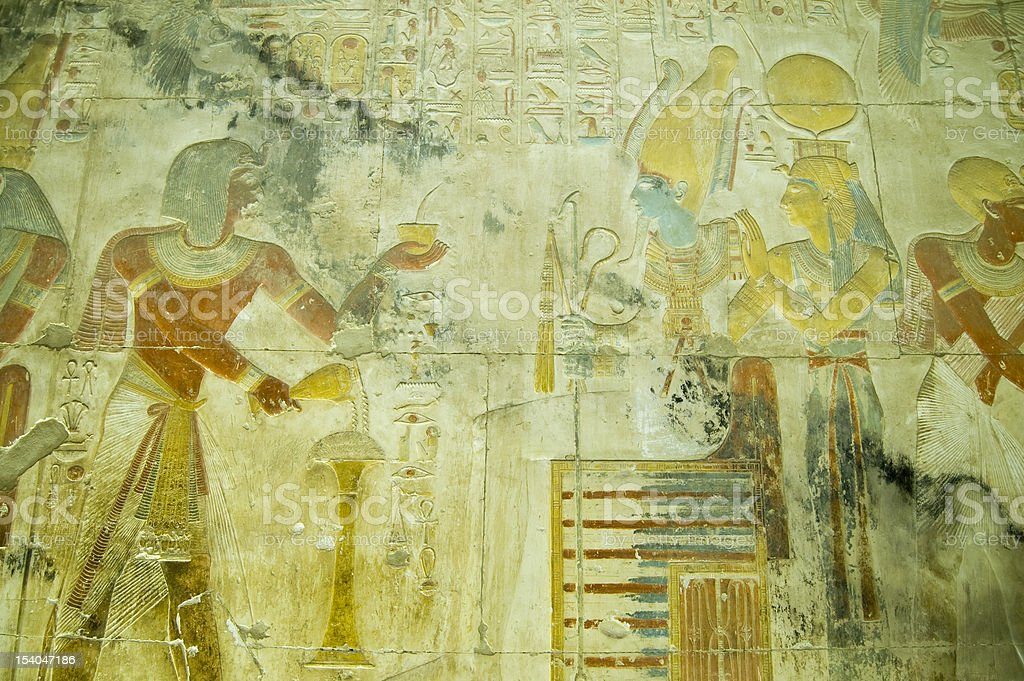 Seti with Osiris and Isis bas relief stock photo