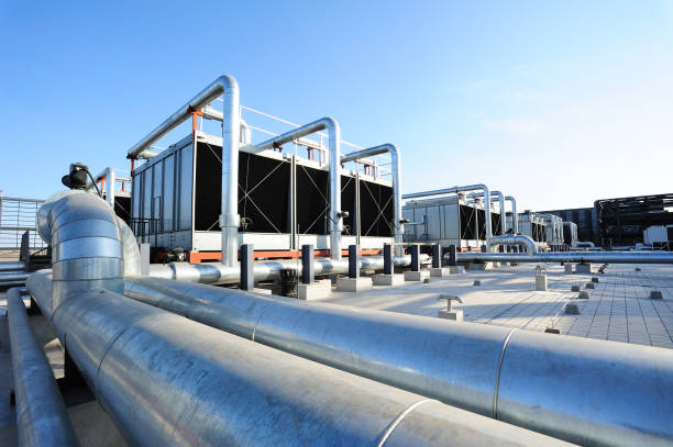 sets of cooling towers - industriële apparatuur stockfoto's en -beelden