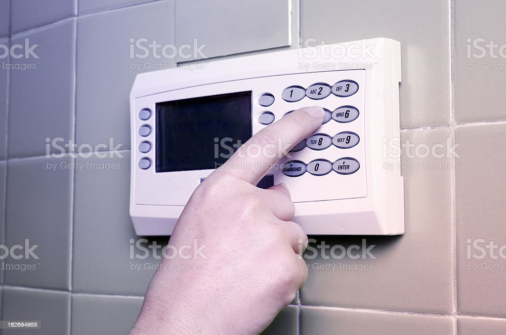 Setting a security alarm system royalty-free stock photo