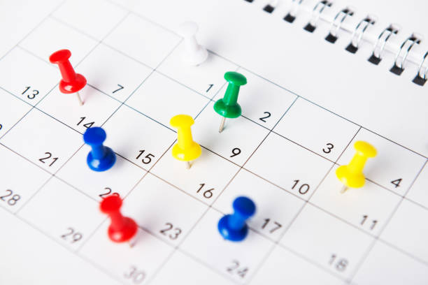 setting an important date on a calendar - calendar date stock photos and pictures