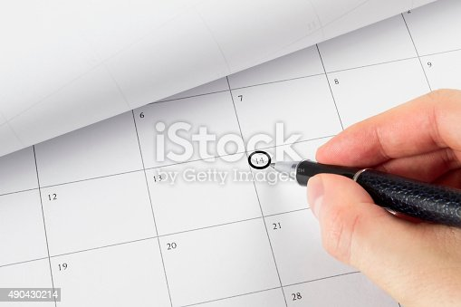 177774403 istock photo Setting an Important Day on Calendar 490430214