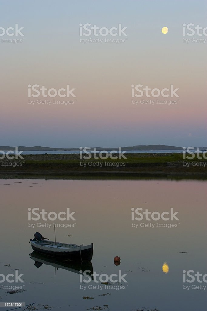 Setting moon just before dawn royalty-free stock photo