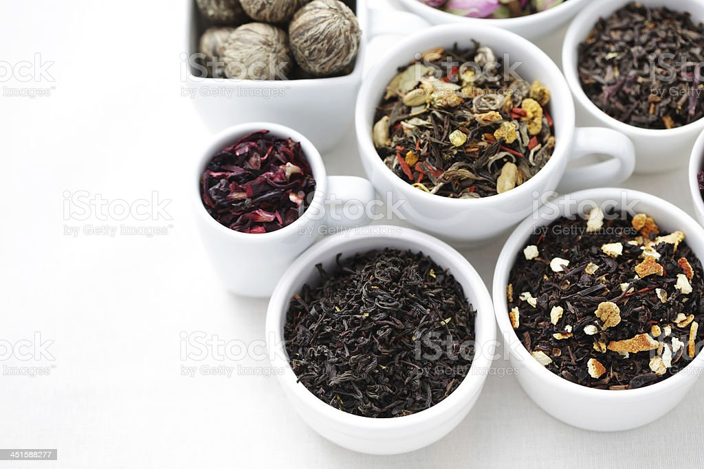 Setting of containers holding teas and herbs for infusions stock photo