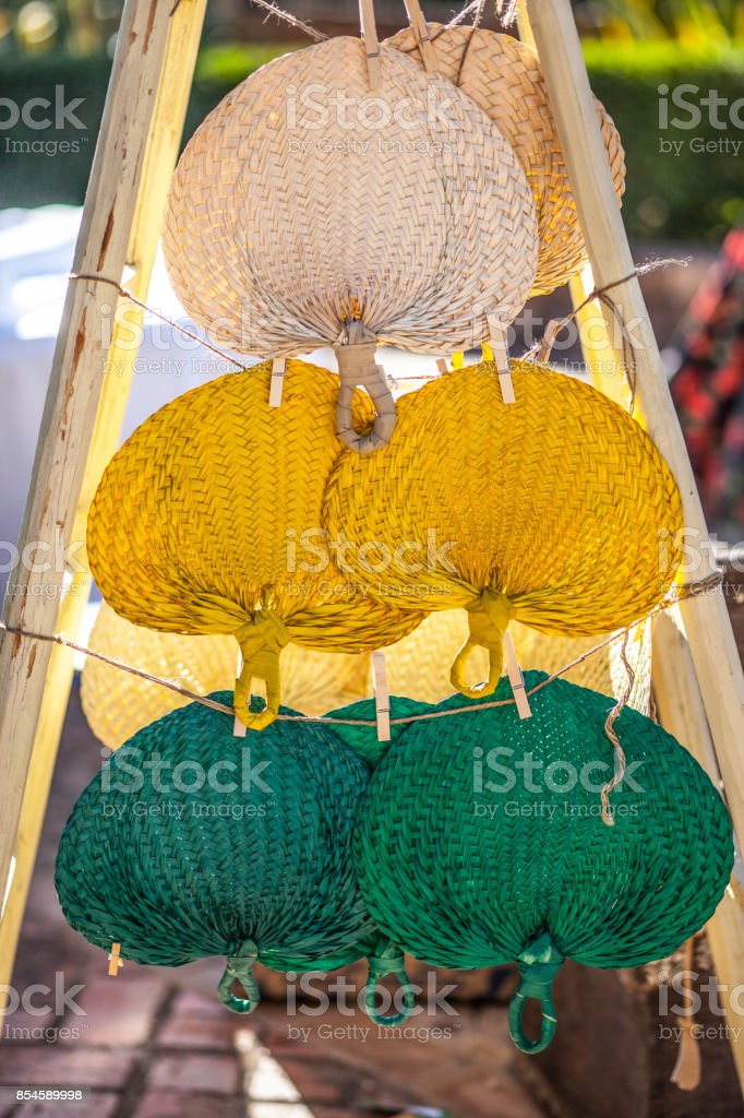 Setting of handheld fans for wedding guests stock photo