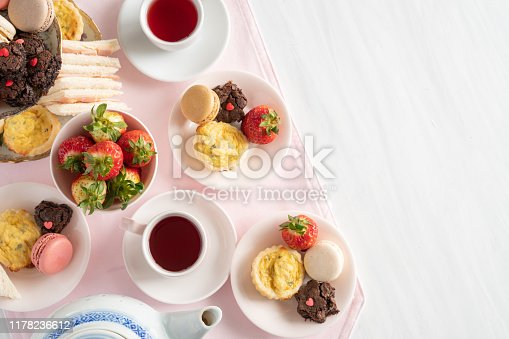 Setting of High Tea from Above with Copy Space with Macaroons, Brownies, Quiche, Sandwiches, and Tea