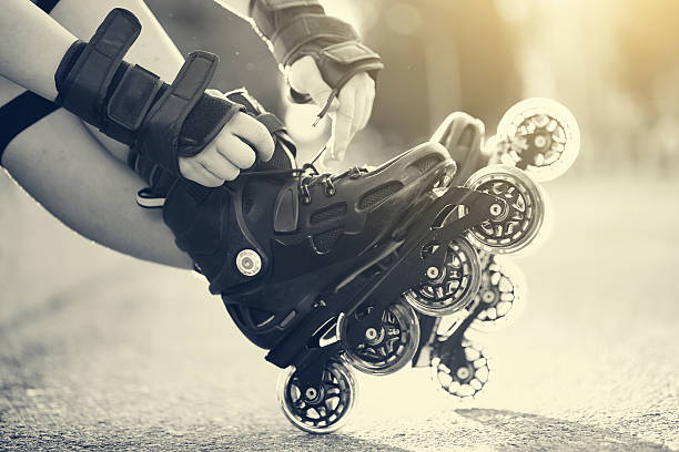 Setting of laces on roller skates stock photo