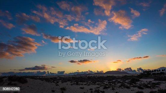 istock Setting sun in  Park Natural, Corralejo, Fuerteventura, Canary i 508542280