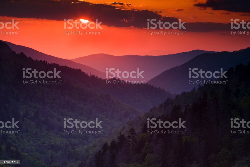 Setting Sun in the Mountains stock photo