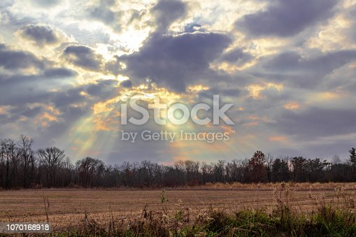 Sun rays beaming through dark clouds