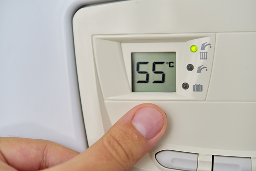 istock Setting the central heating level in gas furnace panel 871525562
