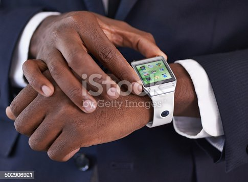 Cropped view of a young businessman wearing a smartwatch - All screen content is designed by us and not copyrighted by othershttp://195.154.178.81/DATA/i_collage/pi/shoots/783764.jpg