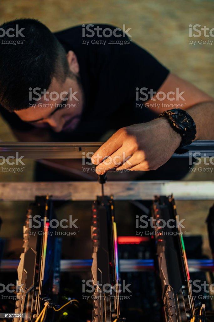 Setting up a bitcoin mining farm stock photo