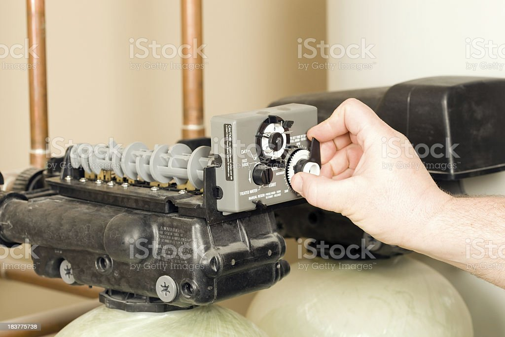 Setting Water Filter/Softener Control Timer stock photo