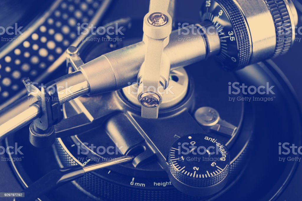 Setting weight and anti-skating customization on turntable stock photo
