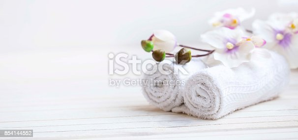 istock SPA setting with bath towels and orchid flower, selective focus 854144552