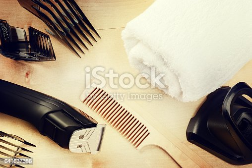 istock Setting with hair clipper and wooden comb 641637386