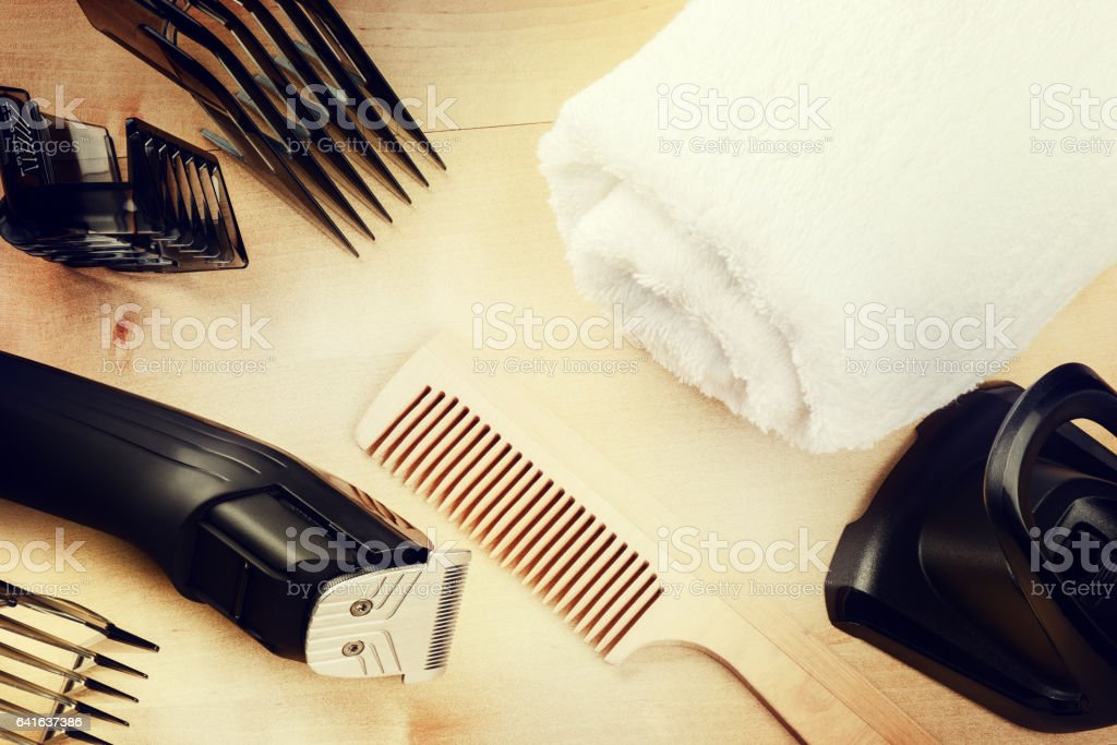 Setting with hair clipper and wooden comb stock photo