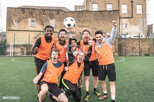 istock Seven a side football team cheering with ball in the air 963295624