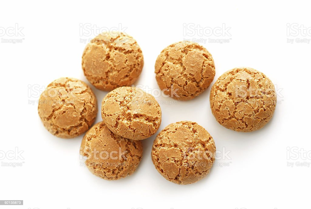 Seven amaretti cookies laying on a surface stock photo